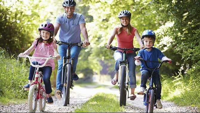 Family bike riding on trail N1504P37013C
