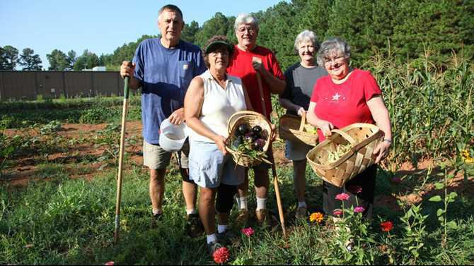 Master Gardeners in garden behind Dixie Graphics IMG 0014