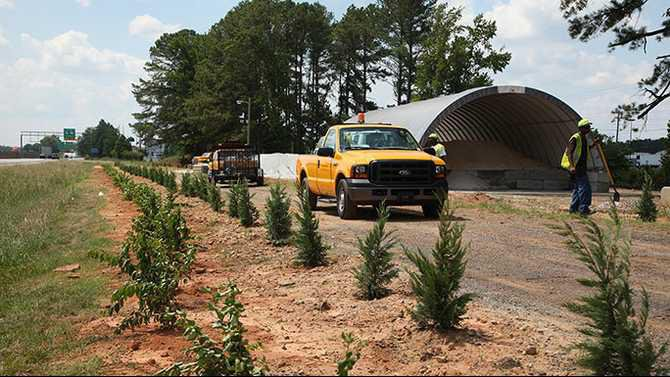 GDOT salt barn on I-20 near 138 entrance - trees being planted 6-20-12 IMG 5455