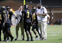 Alcovy Head Coach Jason Dukes, right, speaks to senior Anthony Little (7) during a timeout.